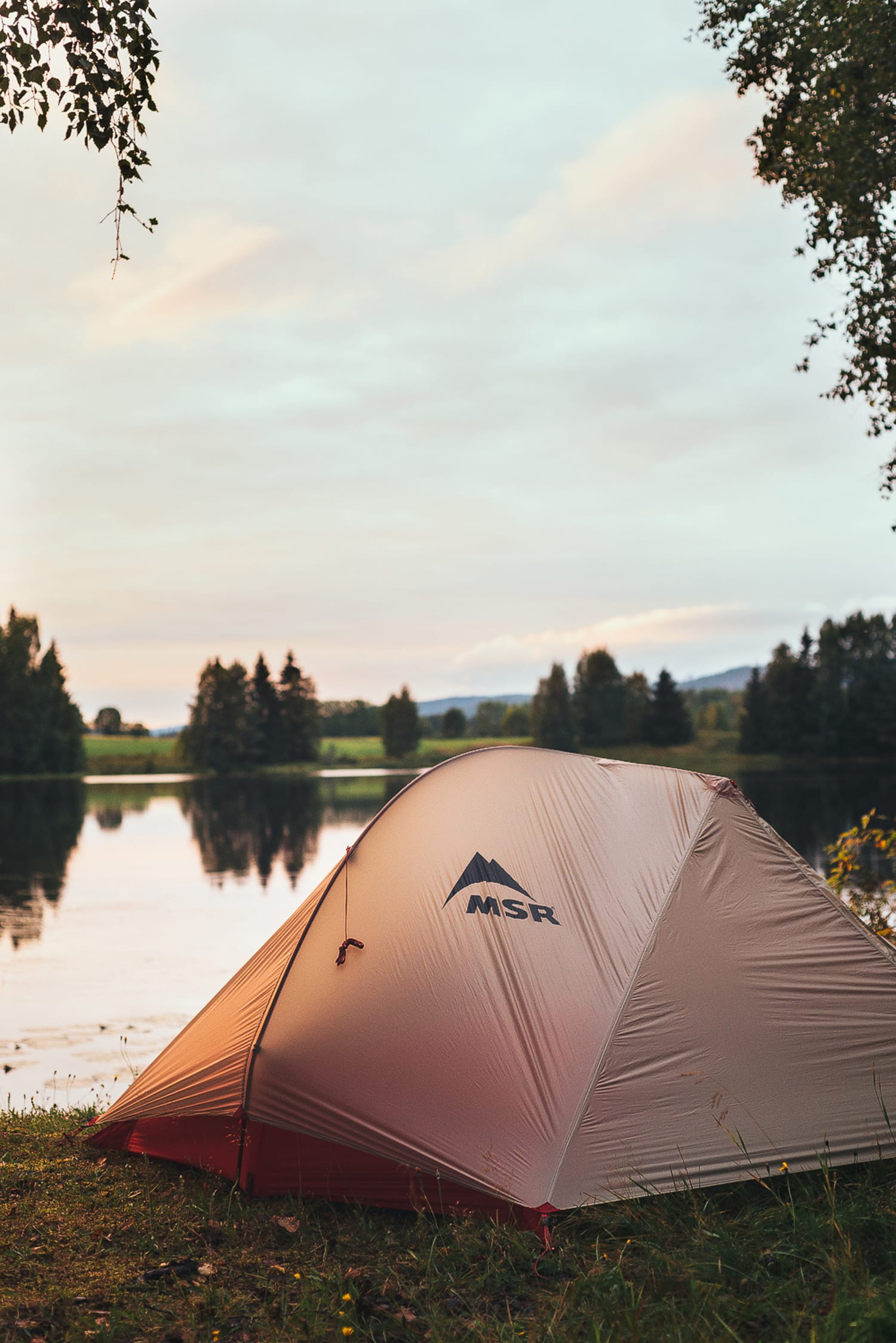 MSR tent pitched by a lake