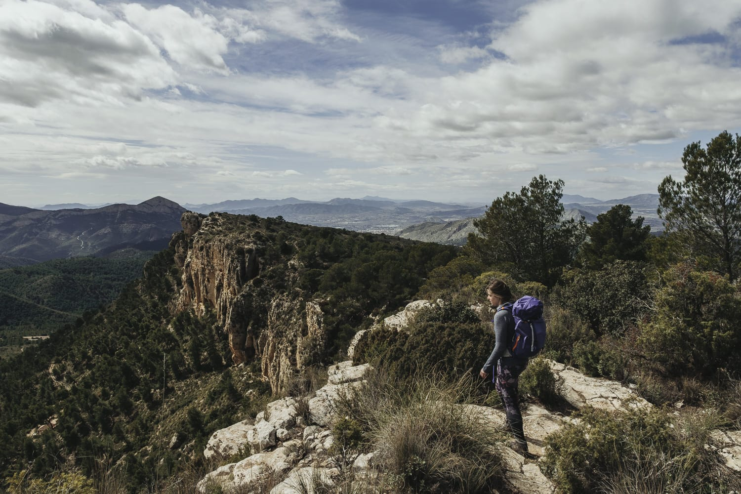 Hiker admiring the view in Serra del Maigmó