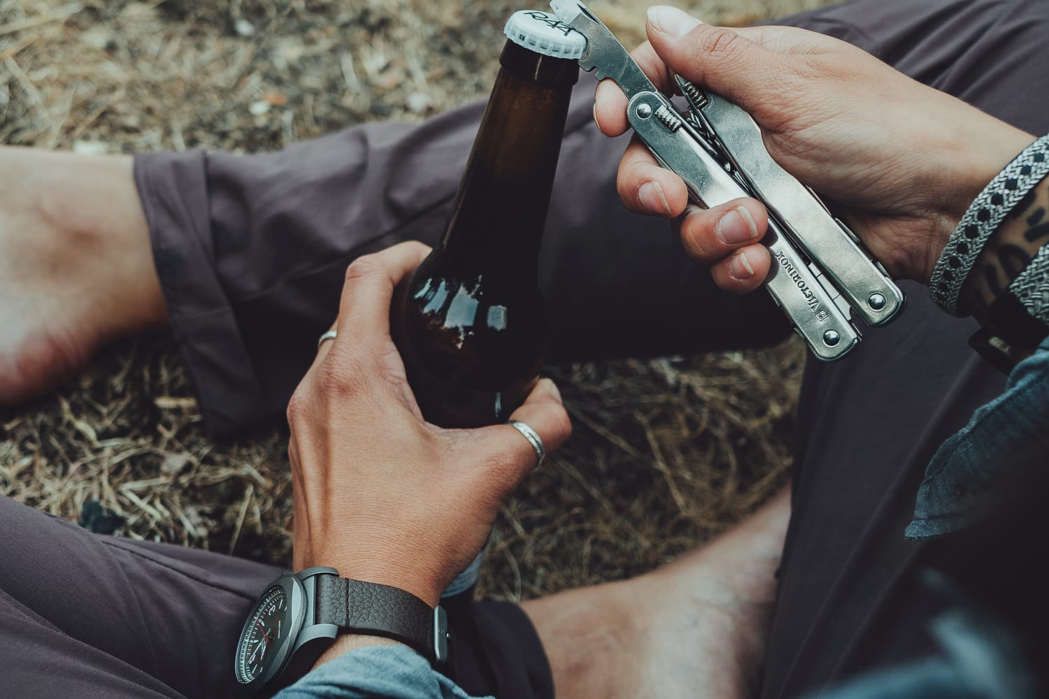 Opening a bottle using a multi-tool from Victorinox