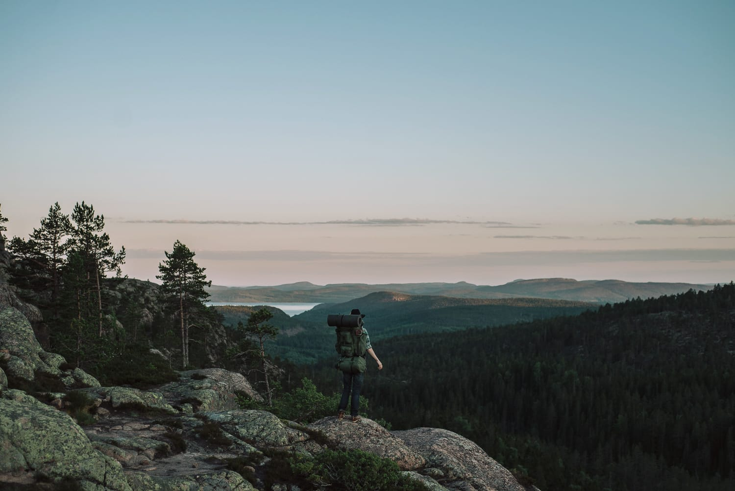 Hiker admiring the view of the High Coast of Sweden