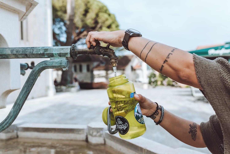 Filligng bottle with water in Herceg Novi