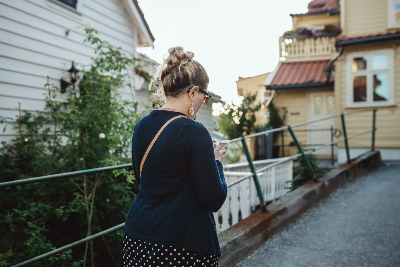 Girl walking and looking at Google Maps