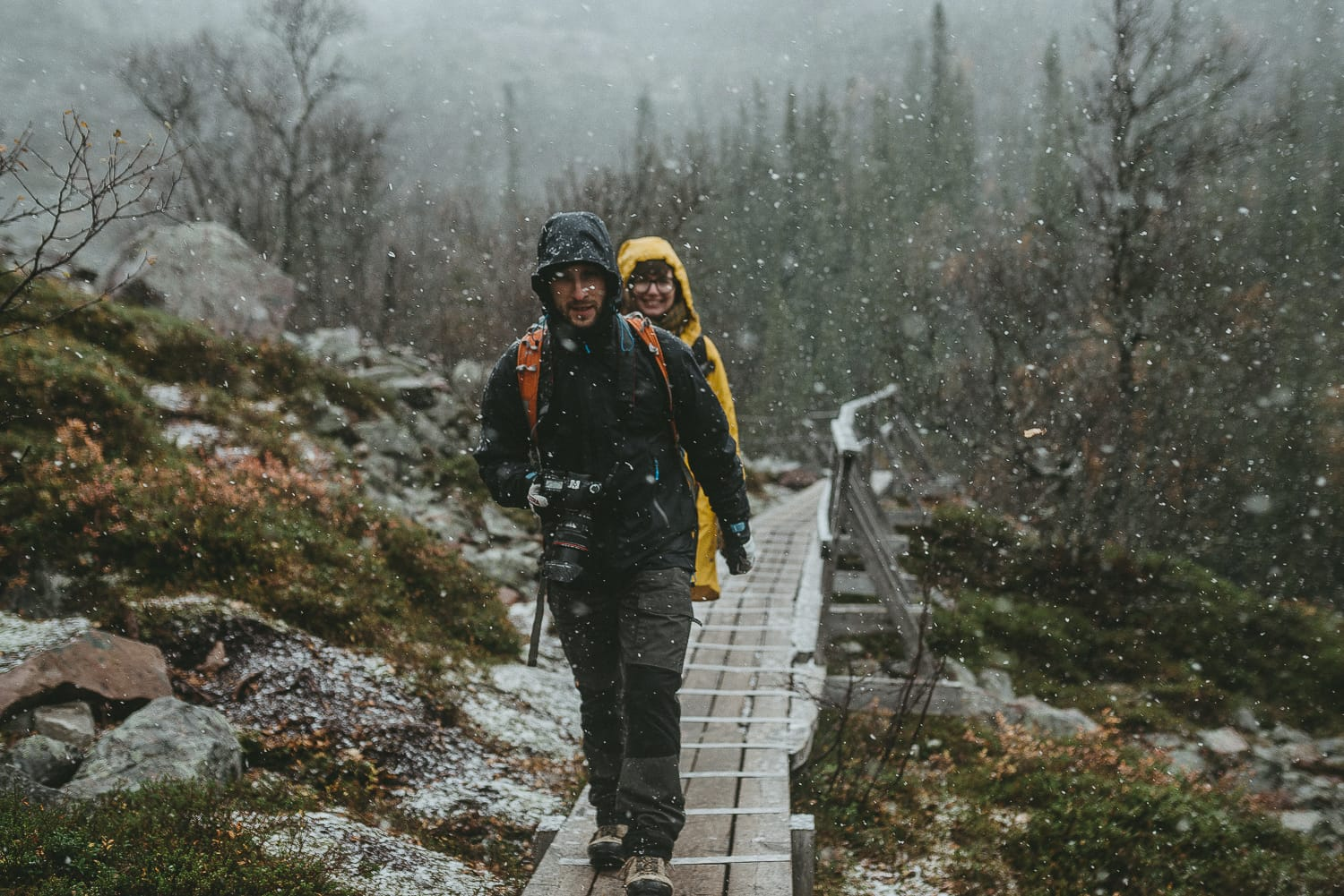 hikers during snowfall