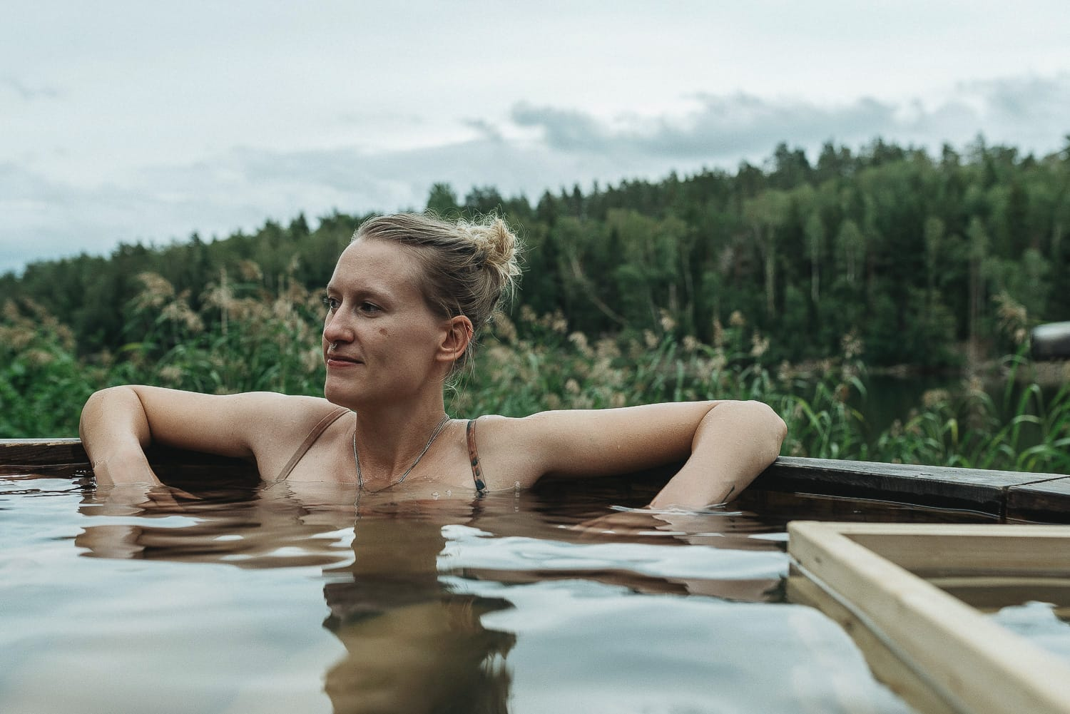 woman in an outdoor hot tub