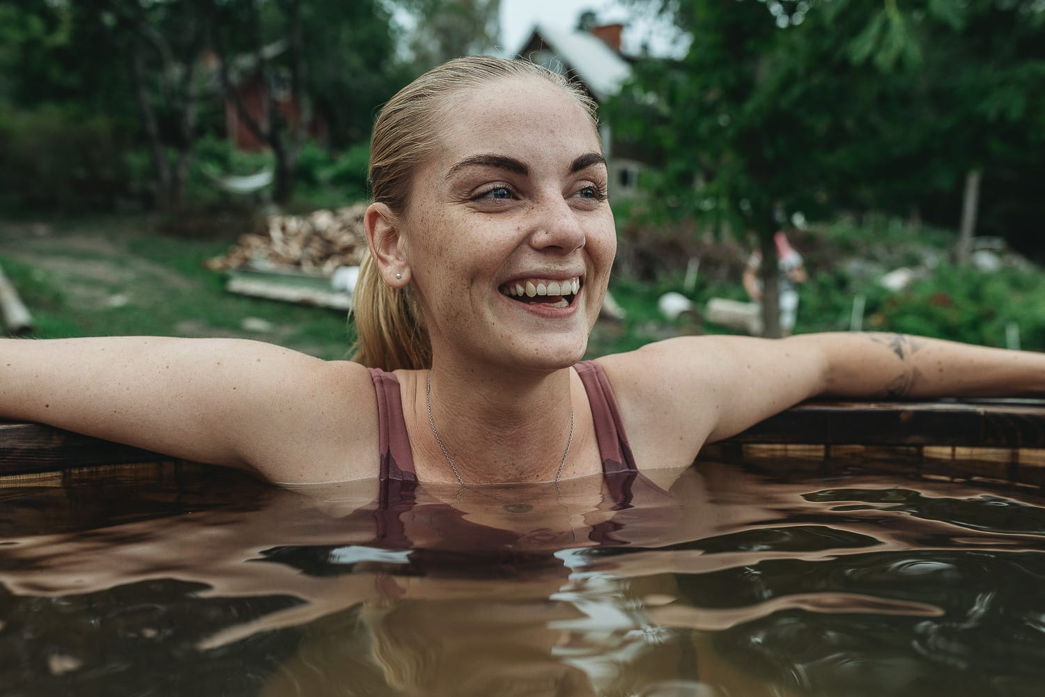 woman laughing in an outdoor hot tub