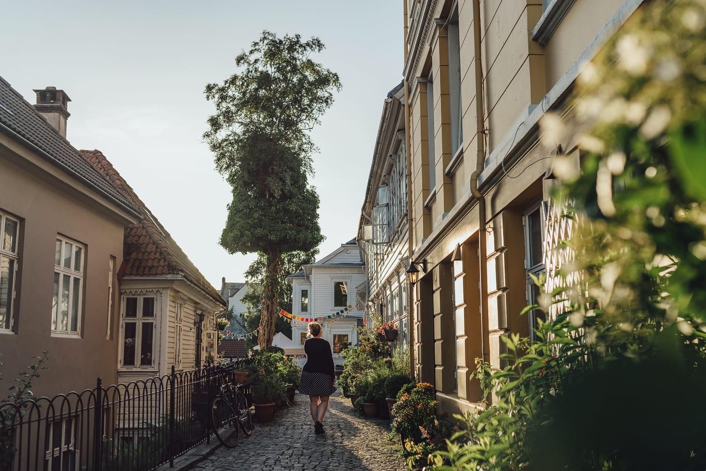 Girl walking down a street in Bergen, Norway