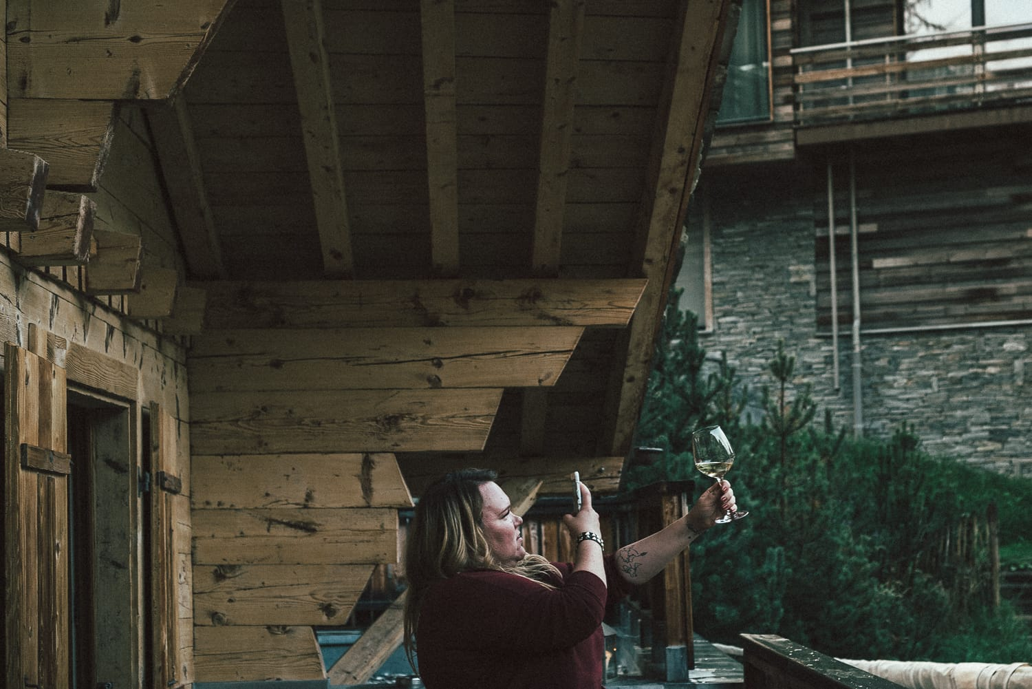 Woman taking a picture of wine at CERVO in Zermatt