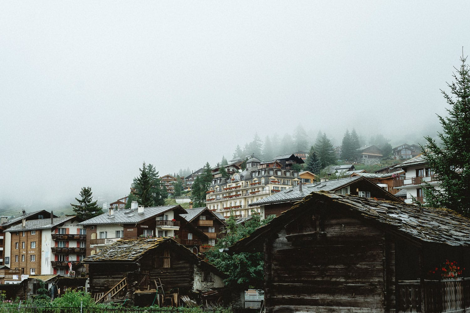 Houses and fog in Zermatt