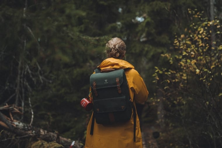 woman hiking in an autumn forest