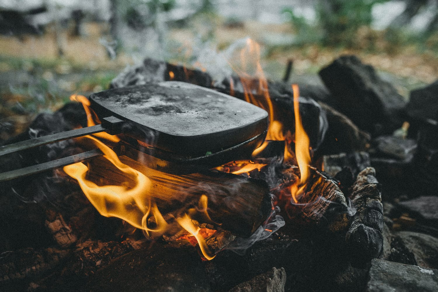 making grilled sandwiches over an open fire