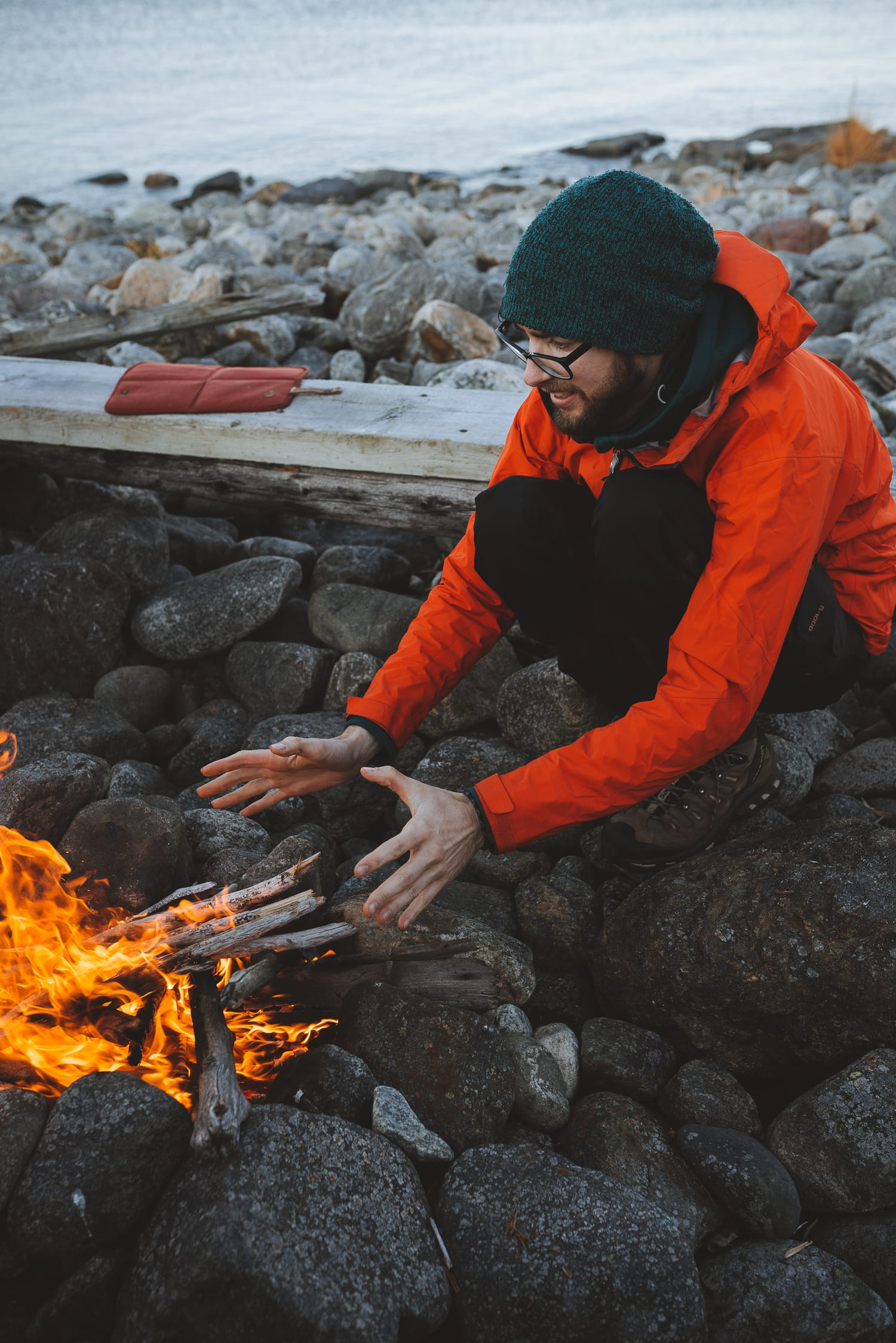 man warming his hands by a fire