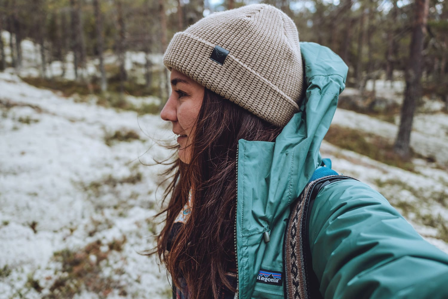 Woman wearing a Patagonia shell in the forest