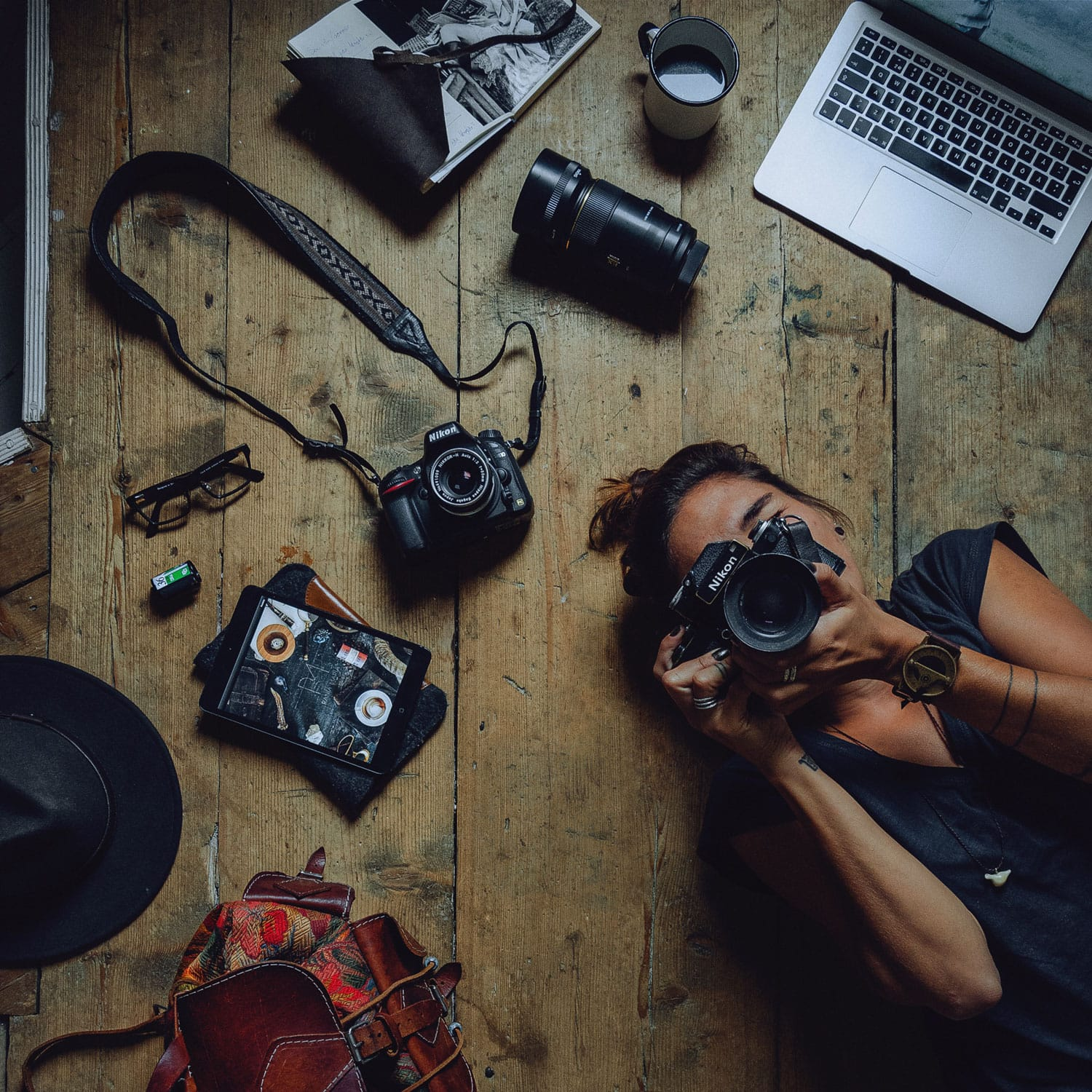Self portrait of a photographer with her gear