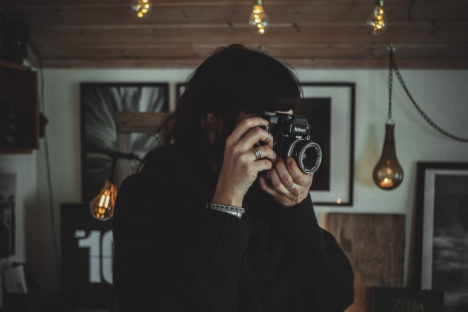 Portrait of female photographer with analogue camera