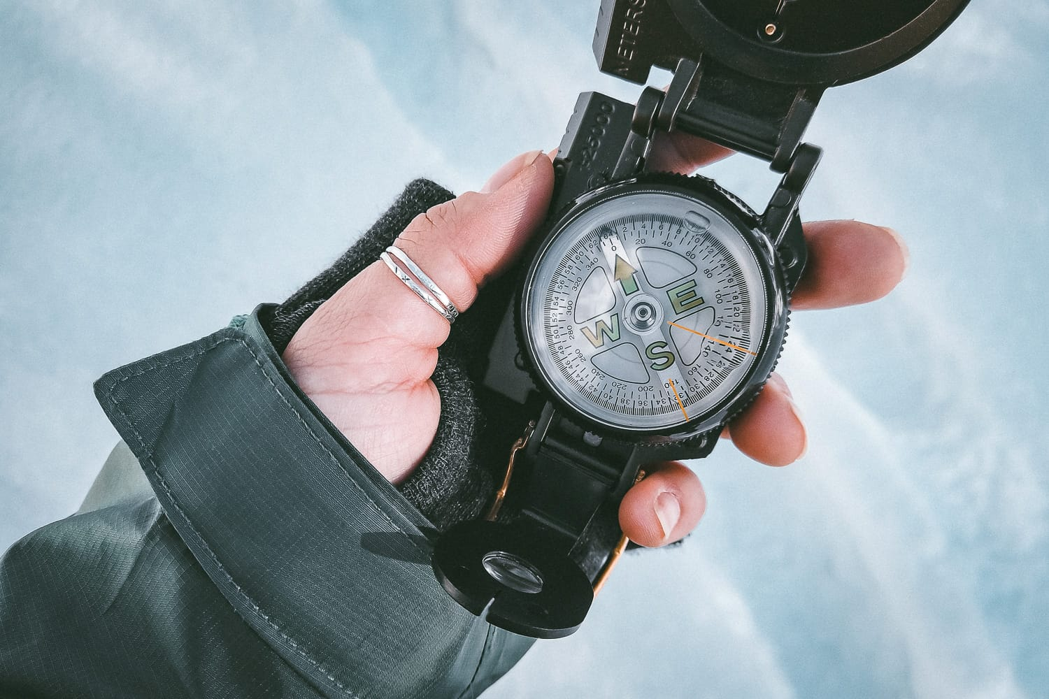 Holding a compass in winter