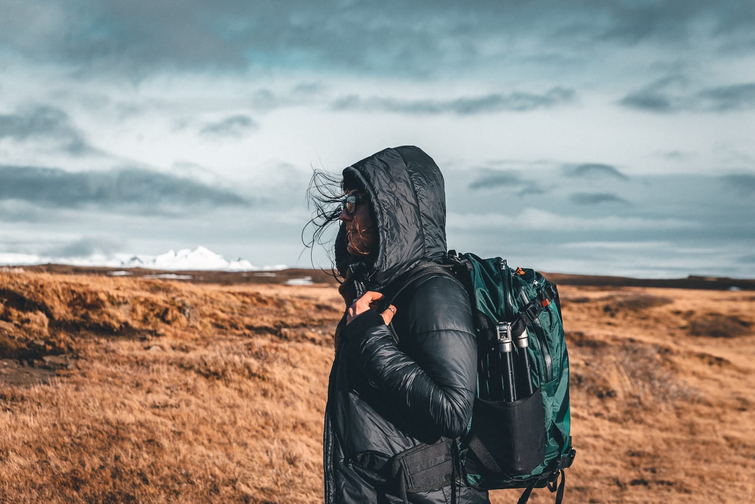 Woman with backpack on Iceland