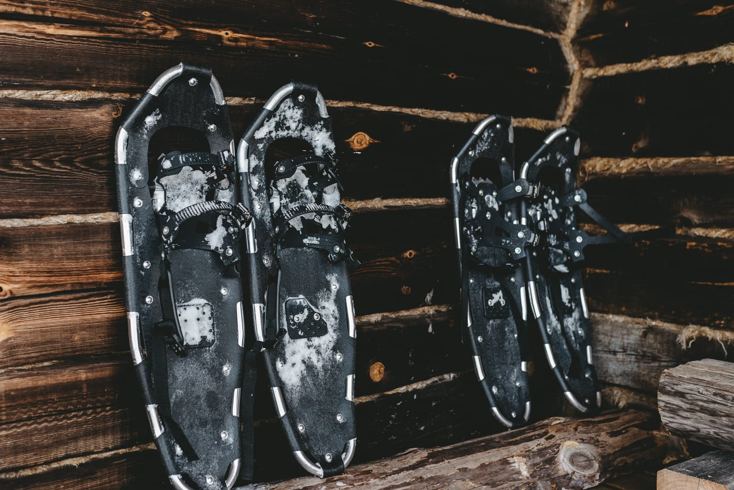 snowshoes by a cabin