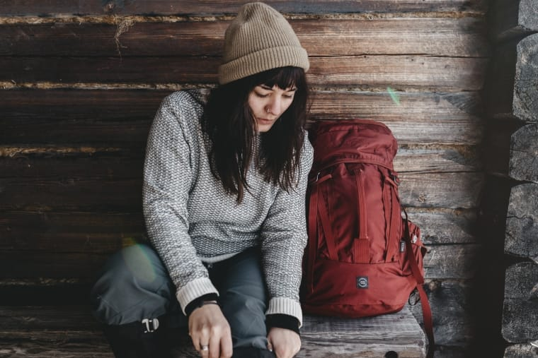 Woman with Lundhags backpack getting ready for a winter hike