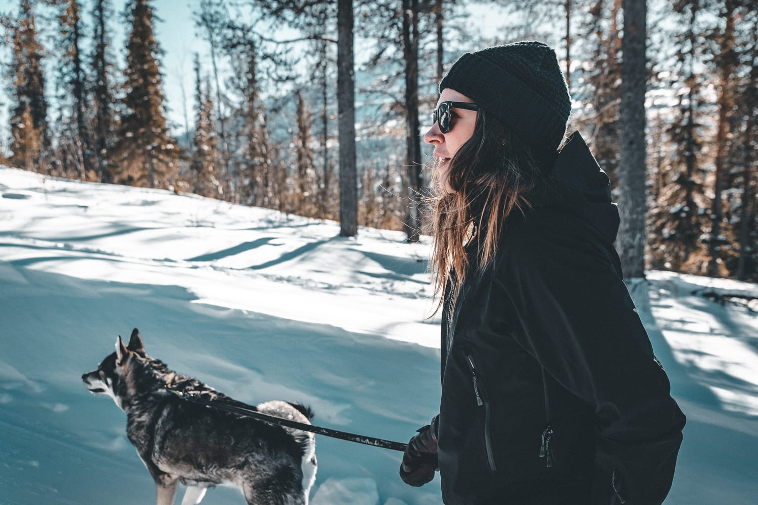 Woman on a winter walk with her dog