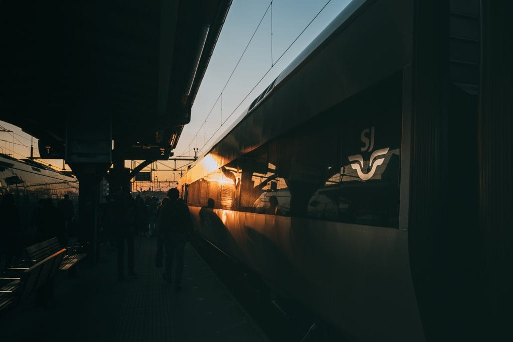 Sunset by a train station and SJ train