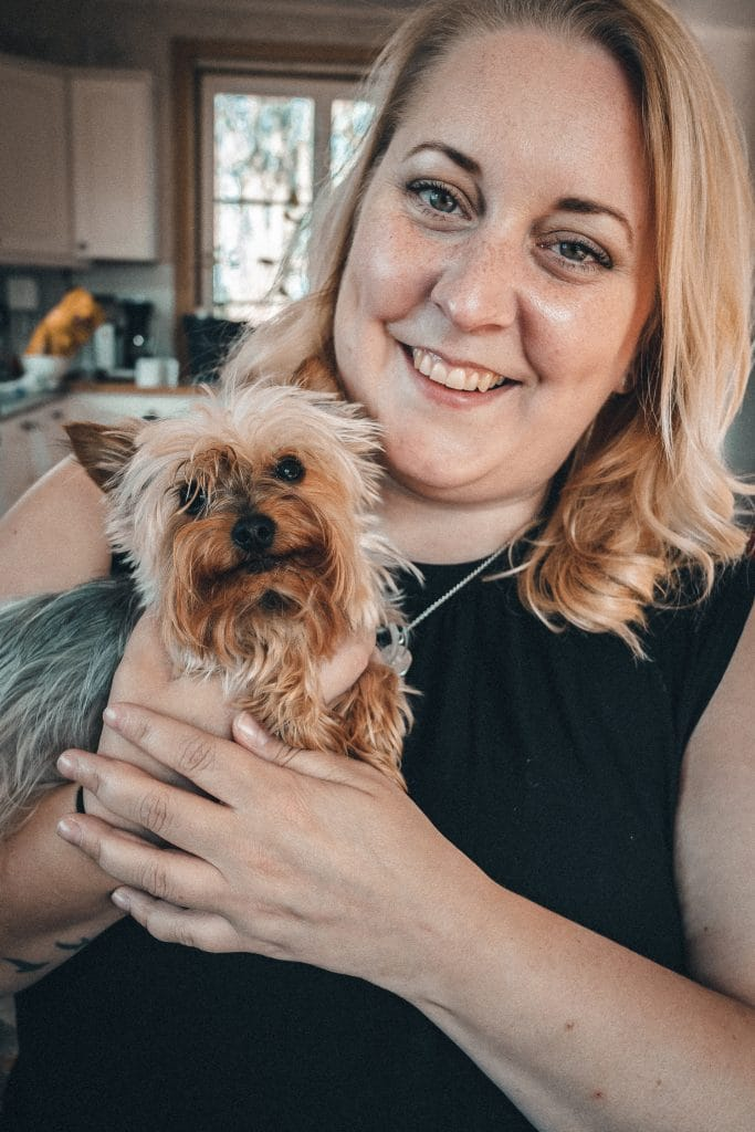 Woman holding a Yorkshire terrier