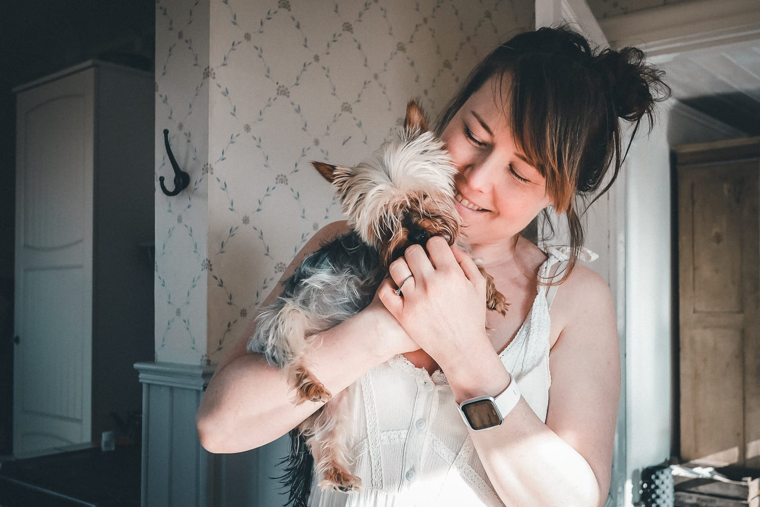 Woman holding her Yorkshire terrier