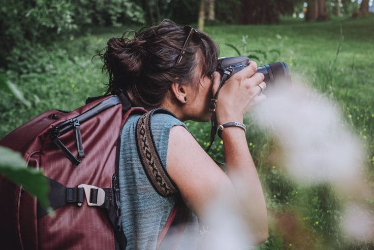 woman taking photos in a park