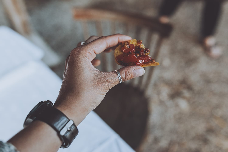 hand holding a bruschetta