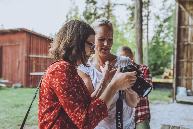 women looking at a camera