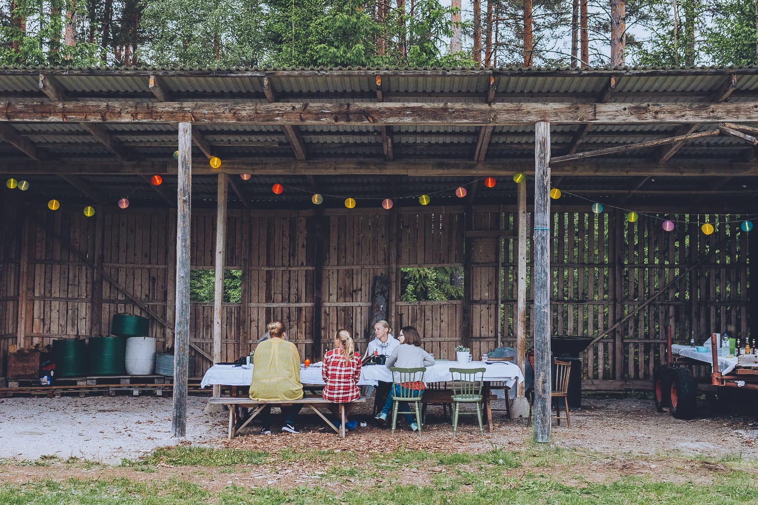 people having dinner in an old shed