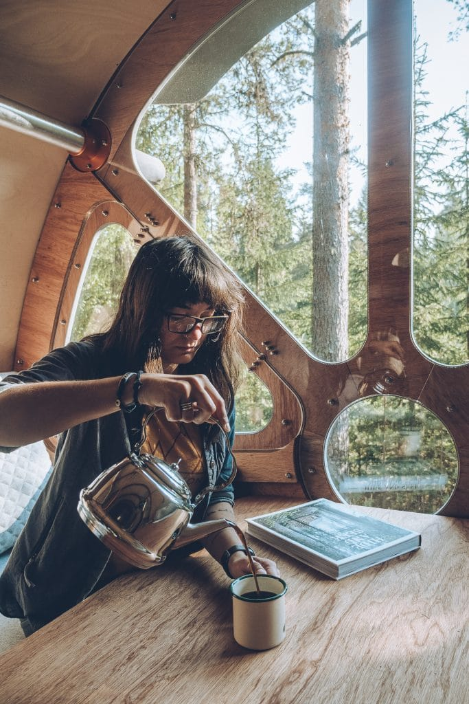 woman pouring coffee in a cabin