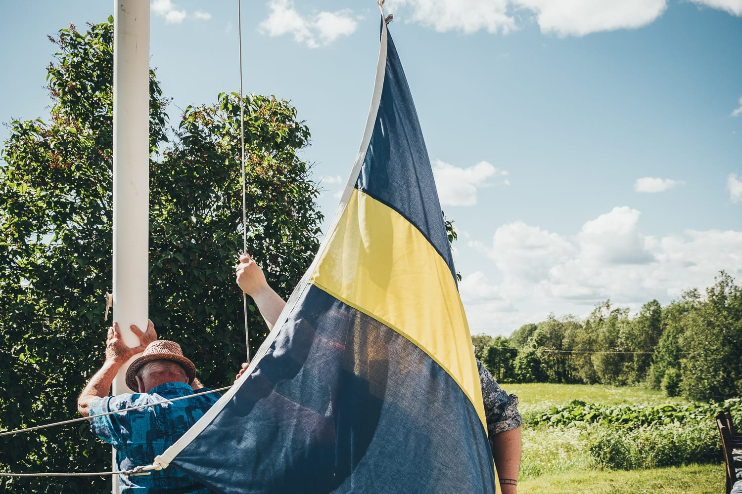 putting up the Swedish flag