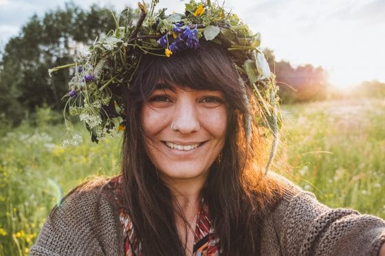 portrait of a woman with a floral crown in the sunset