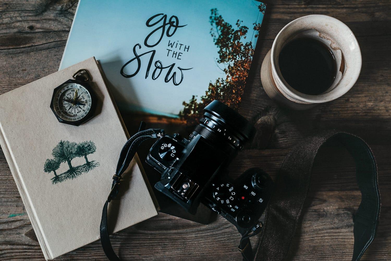 Magazine, camera and coffee
