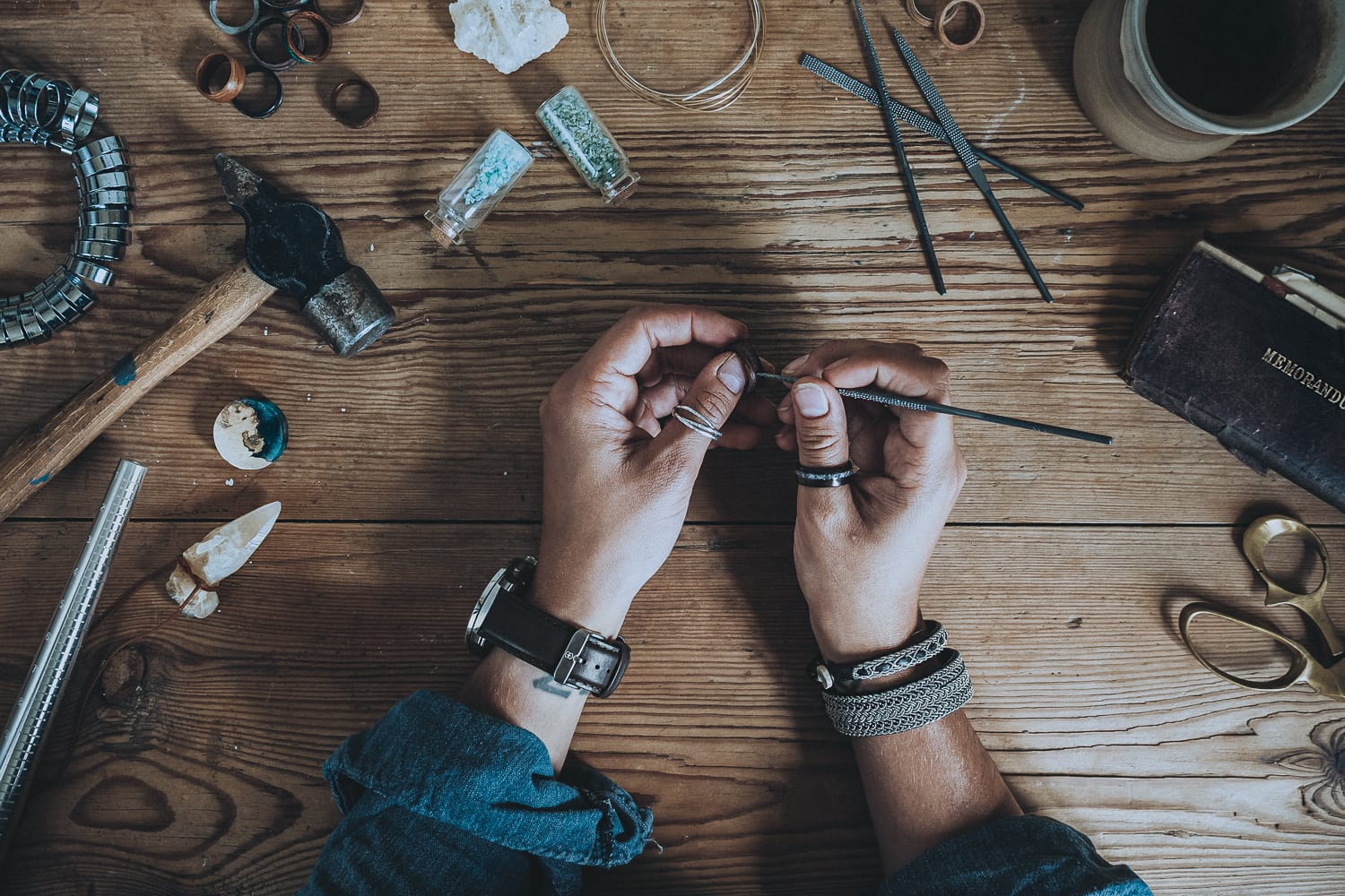 hands working on a wooden ring