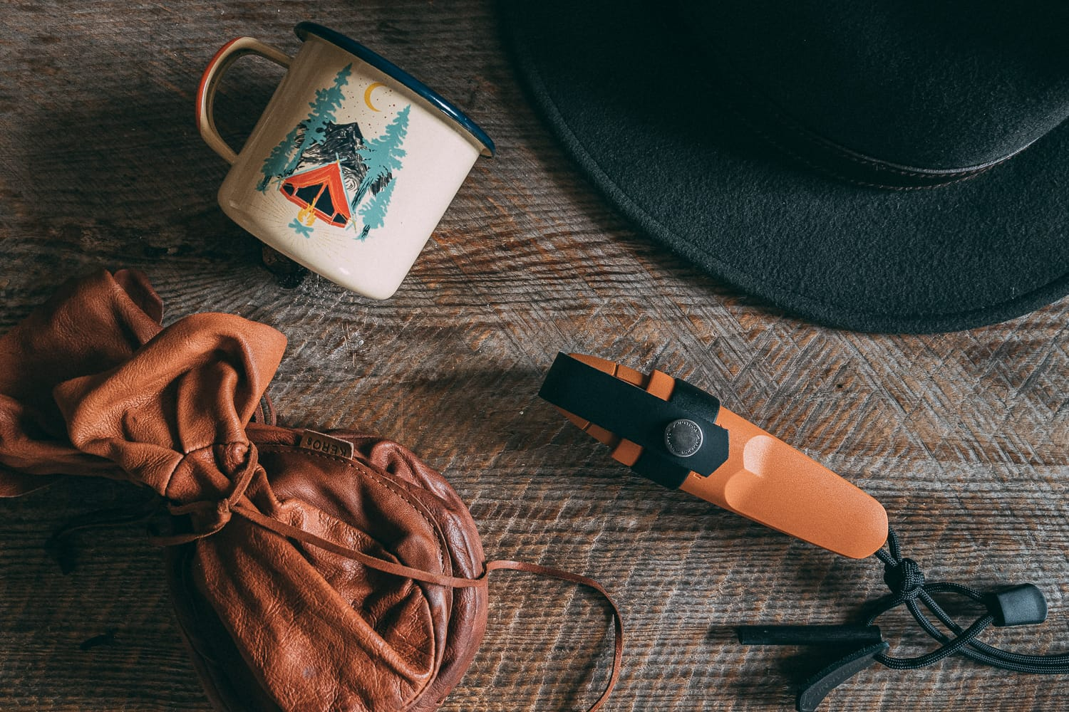 coffee, enamel cup, knife and hat