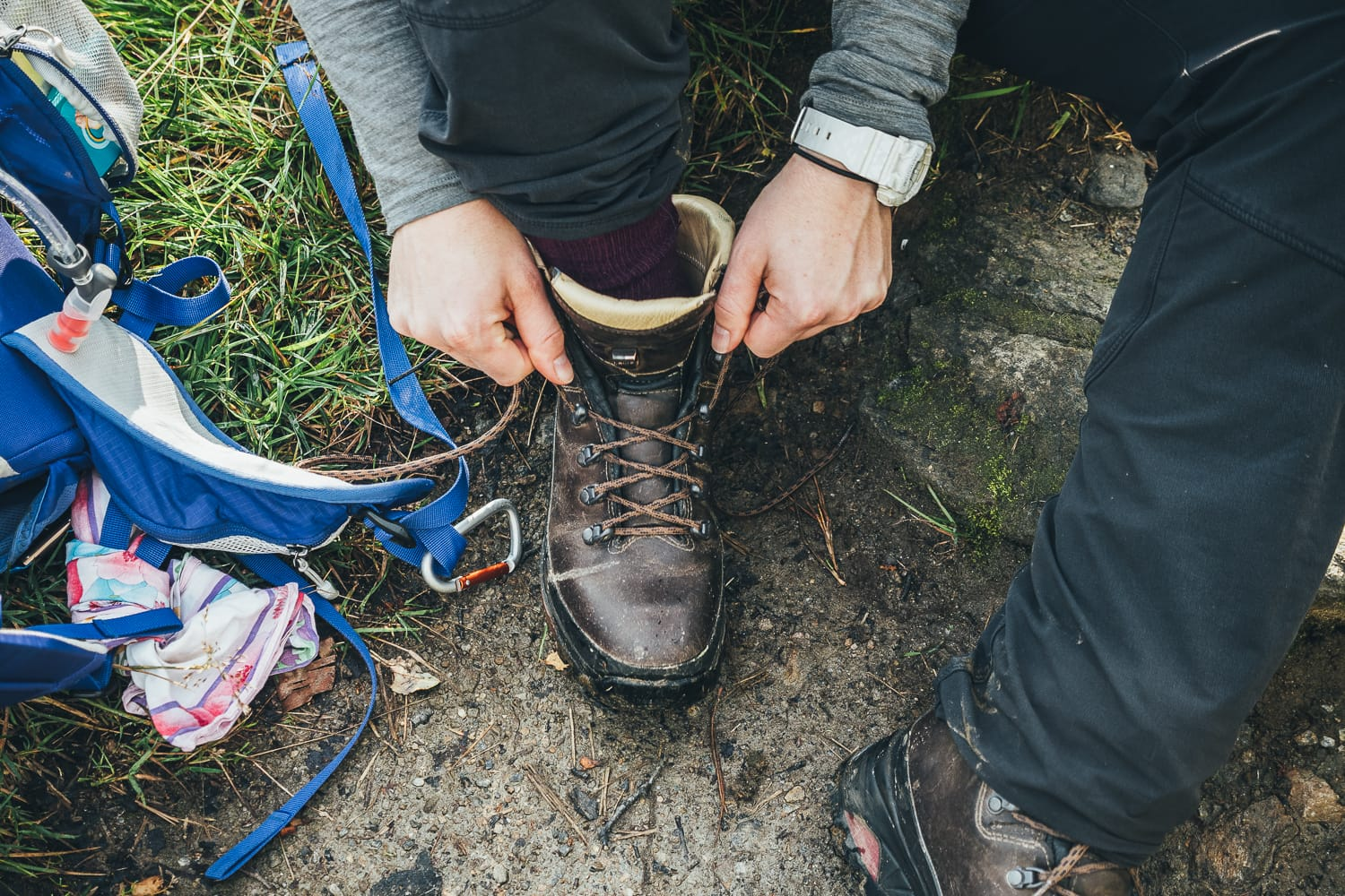 hiker tying her boots