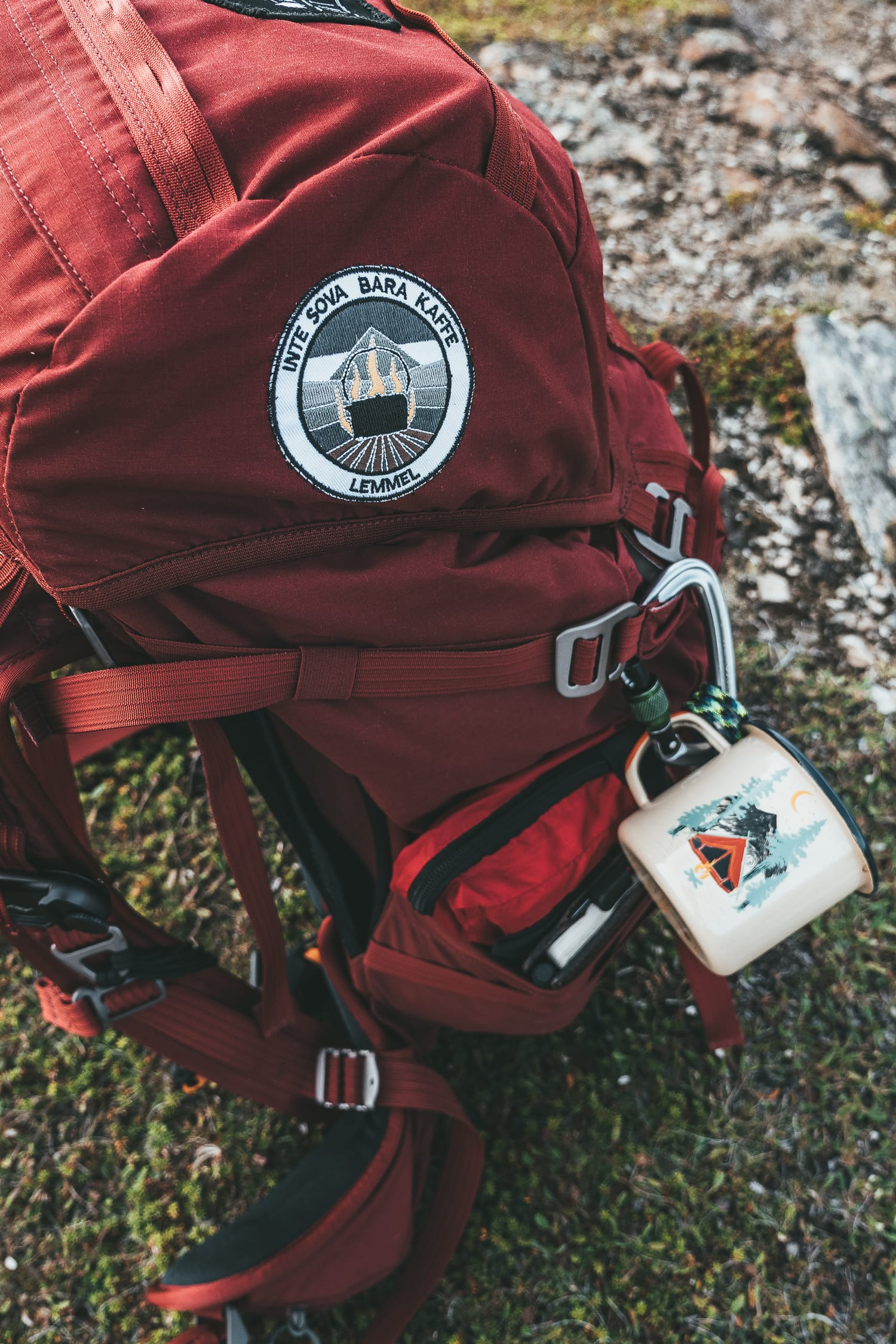 red backpack with patches