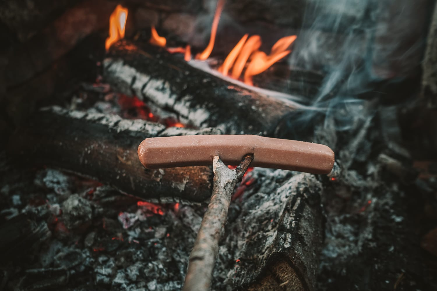 making sausages over open fire