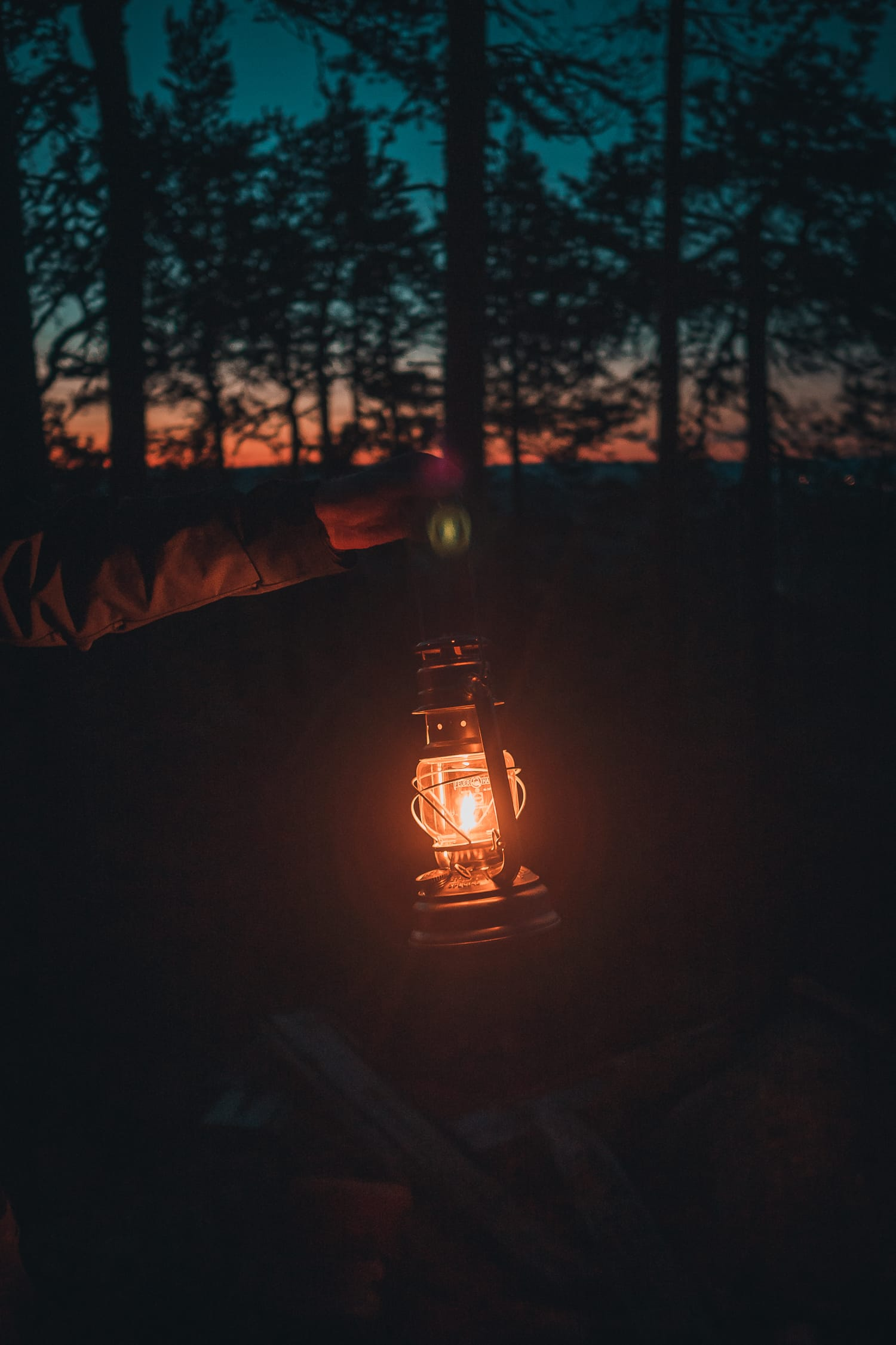 hand holding a lantern in the dark
