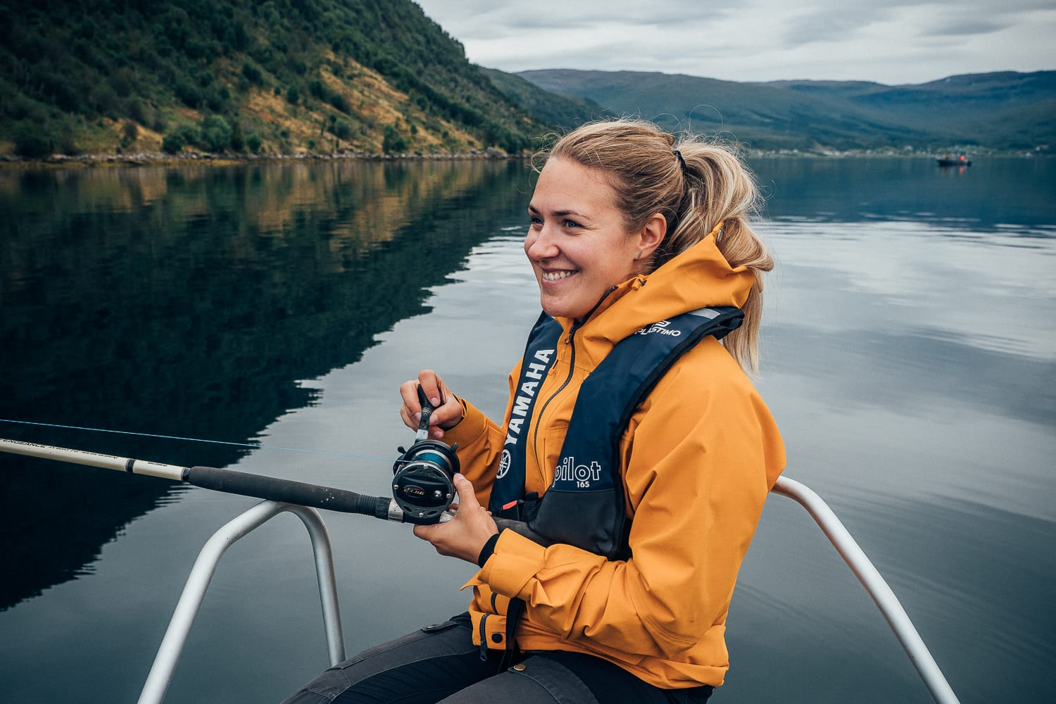 woman fishing in Norway