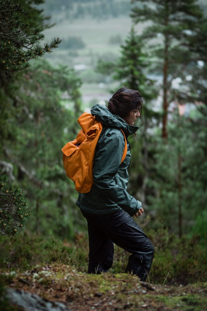 woman hiking in the rain