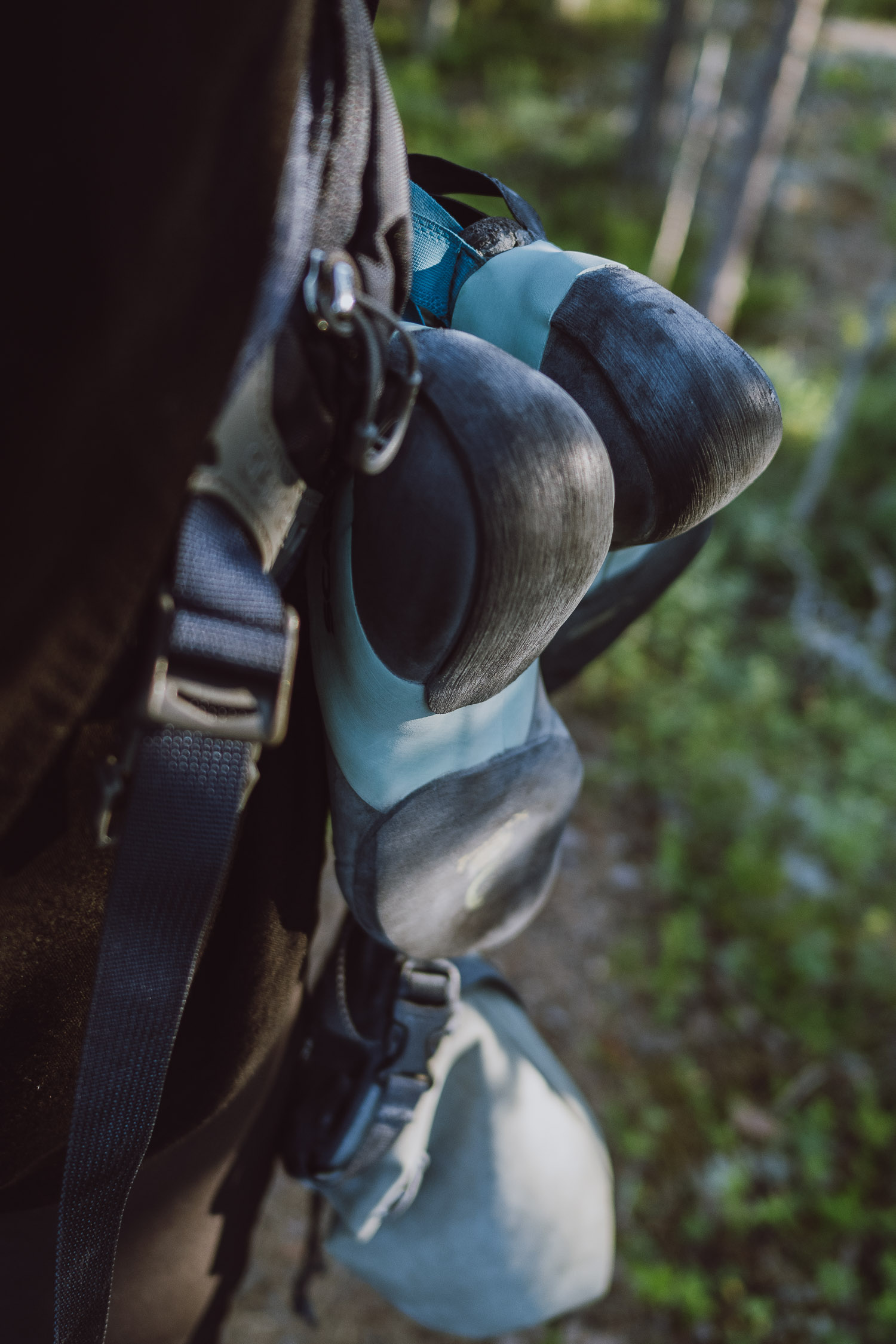 climbing shoes and chalk bag