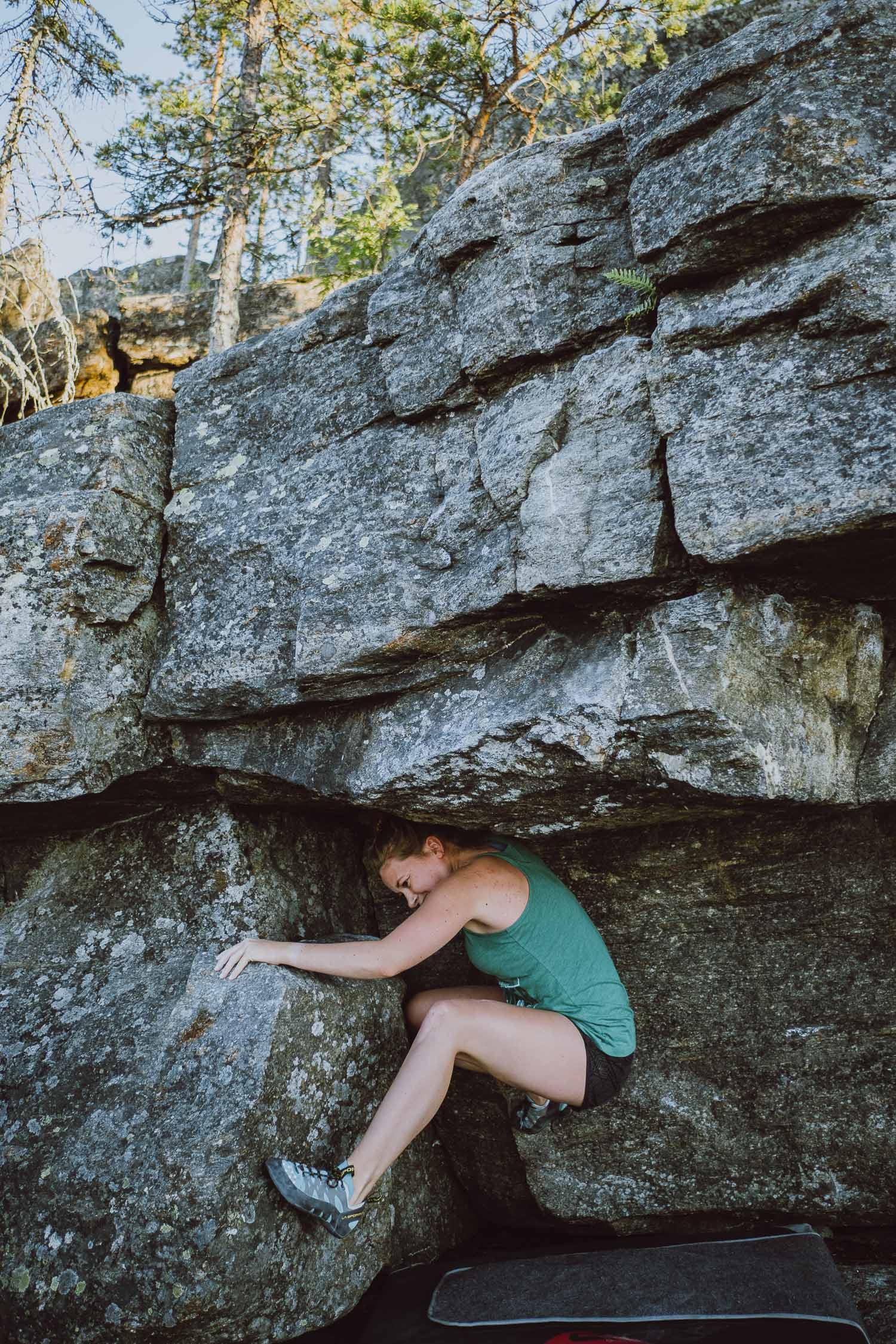 woman bouldering outside
