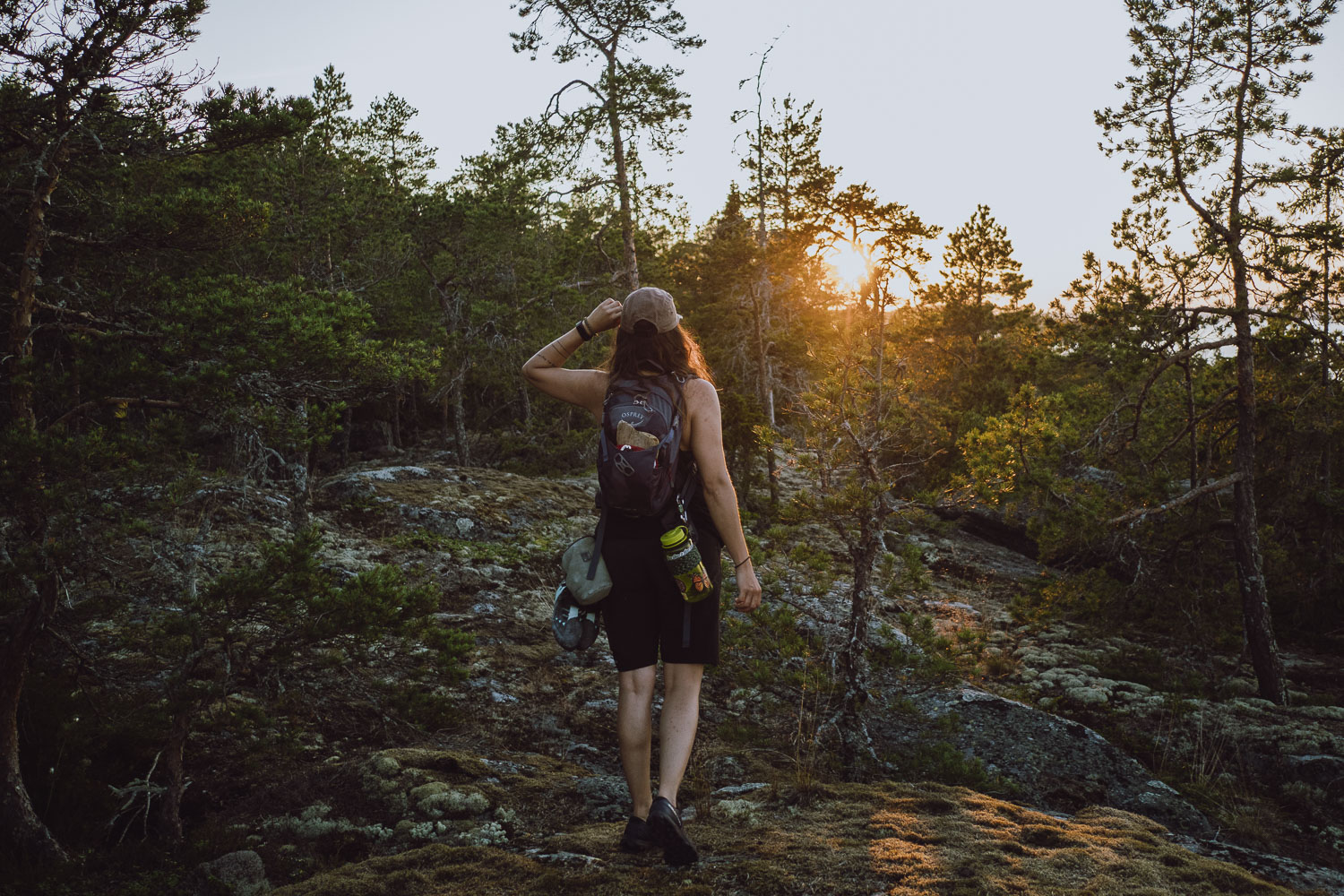 woman hiking in the sunset