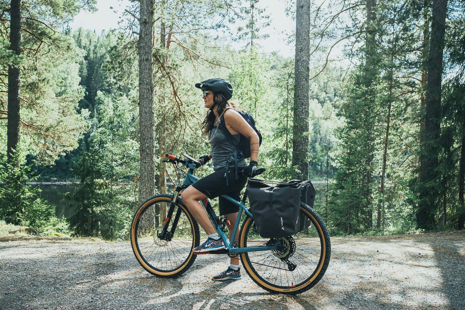 woman on a mountain bike in the forest
