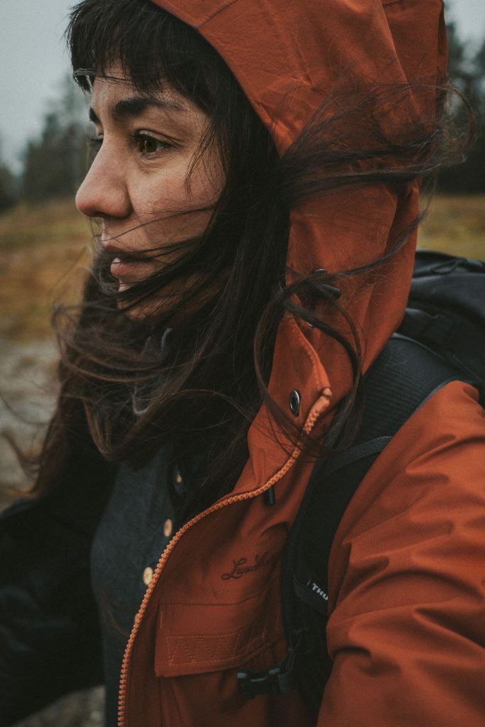 woman out hiking in bad weather