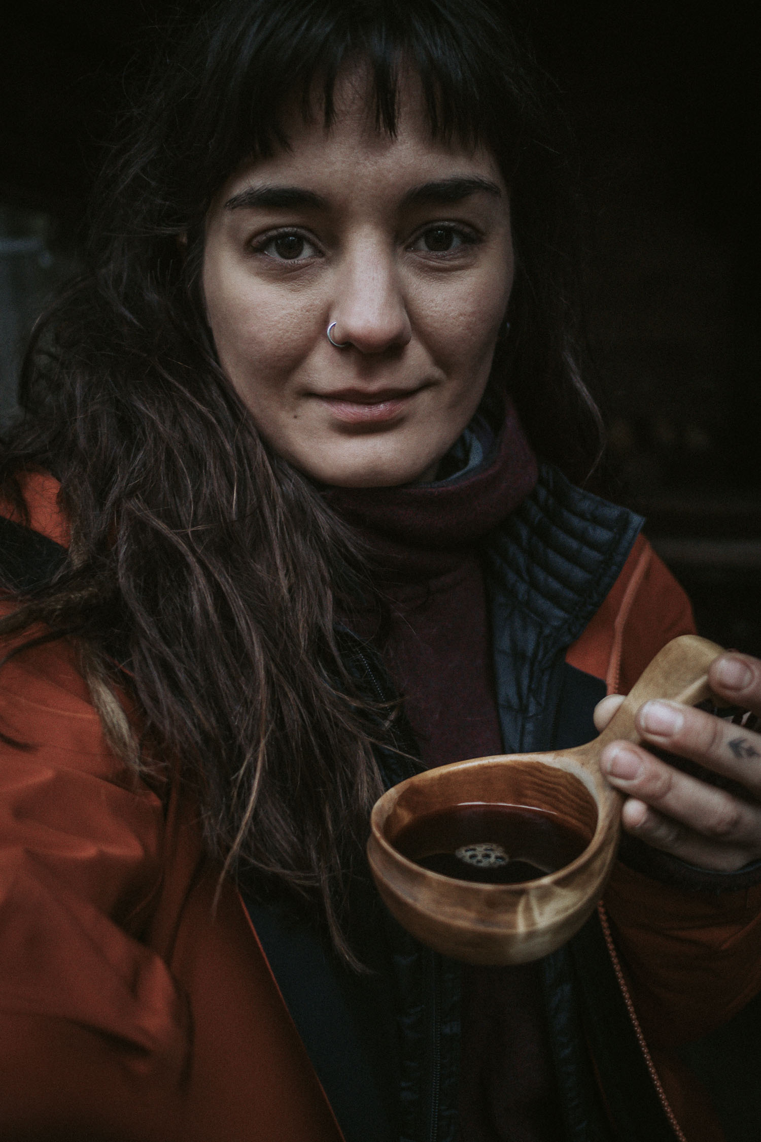 getting out and seeing the beauty in bad weather | woman drinking coffee from a kuuksa