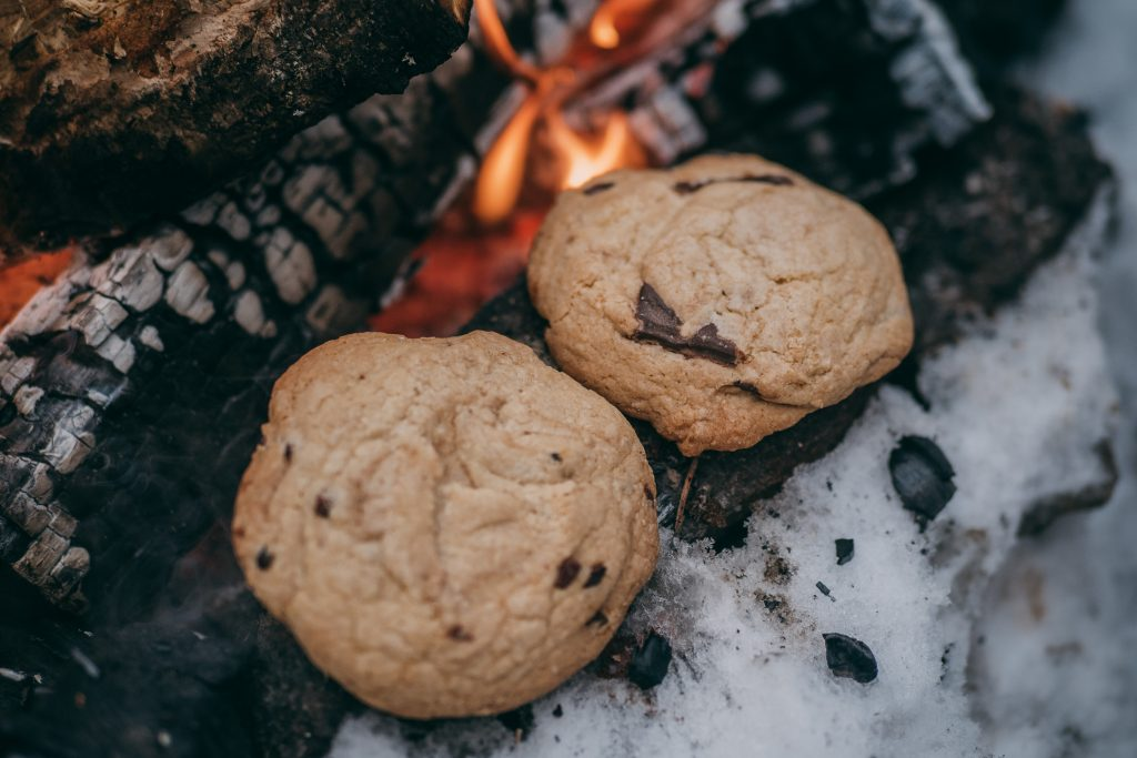 warming up cookies by a fire