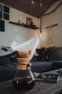 Chemex coffee and magazine on a table